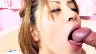 Delicious Asian schoolgirl gives head